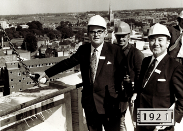 Mr. R. E. Carter topping out Norfolk Tower in 1971